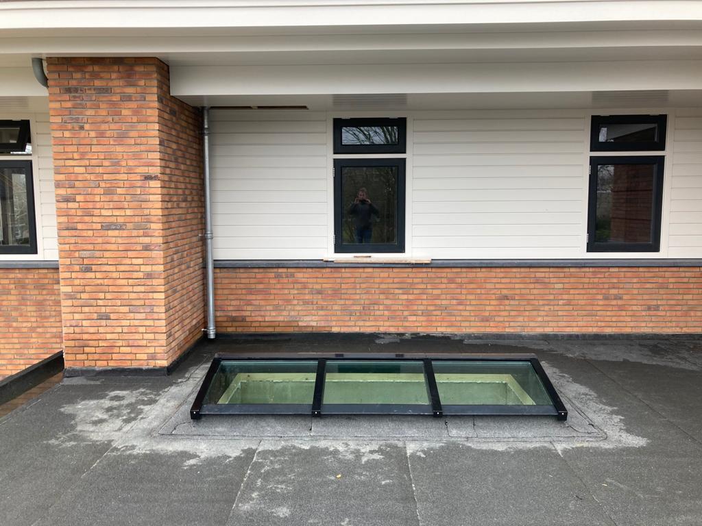 Lichtstraat plat dak uitbouw